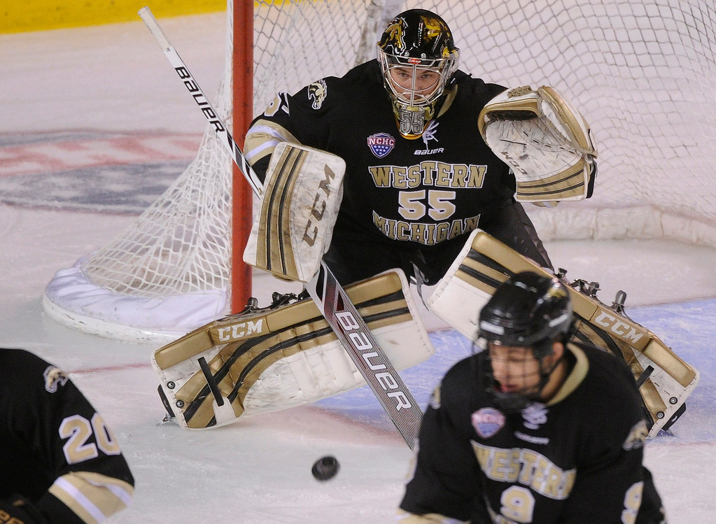 . DENVER, CO. - NOVEMBER 16: Western Michigan goaltender Lukas Hafner prepared for an incoming shot in the first period. The University of Denver hockey team hosted Western Michigan at Magness Arena Saturday night, November 16, 2013.  Photo By Karl Gehring/The Denver Post