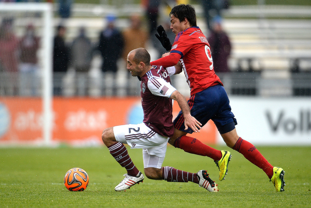 . Erick Torres (9) of Chivas USA gets physical with Nick LaBrocca (2) of Colorado Rapids during the second half. Chivas USA defeated the Colorado Rapids 3-1 on Sunday, May 11, 2014. (Photo by AAron Ontiveroz/The Denver Post)
