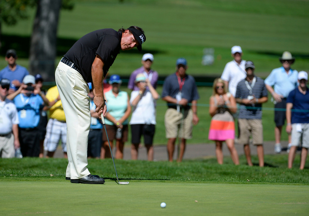 . CHERRY HILLS VILLAGE, CO. - SEPTEMBER 03:  Phil Mickelson putts on the #1 green during the FedExCup BMW Championship Pro-Am at the Cherry Hills Country Club Wednesday afternoon,  September 03, 2014. (Photo By Andy Cross / The Denver Post)
