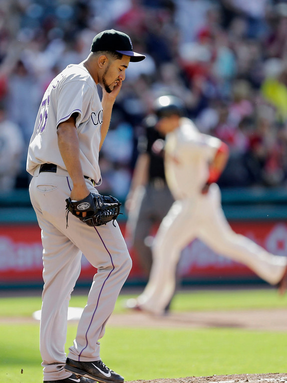 . Colorado Rockies starting pitcher Franklin Morales hangs his head after giving up a two-run hoe run to Cleveland Indians\' Lonnie Chisenhall, background, in the sixth inning of a baseball game Saturday, May 31, 2014, in Cleveland. (AP Photo/Mark Duncan)