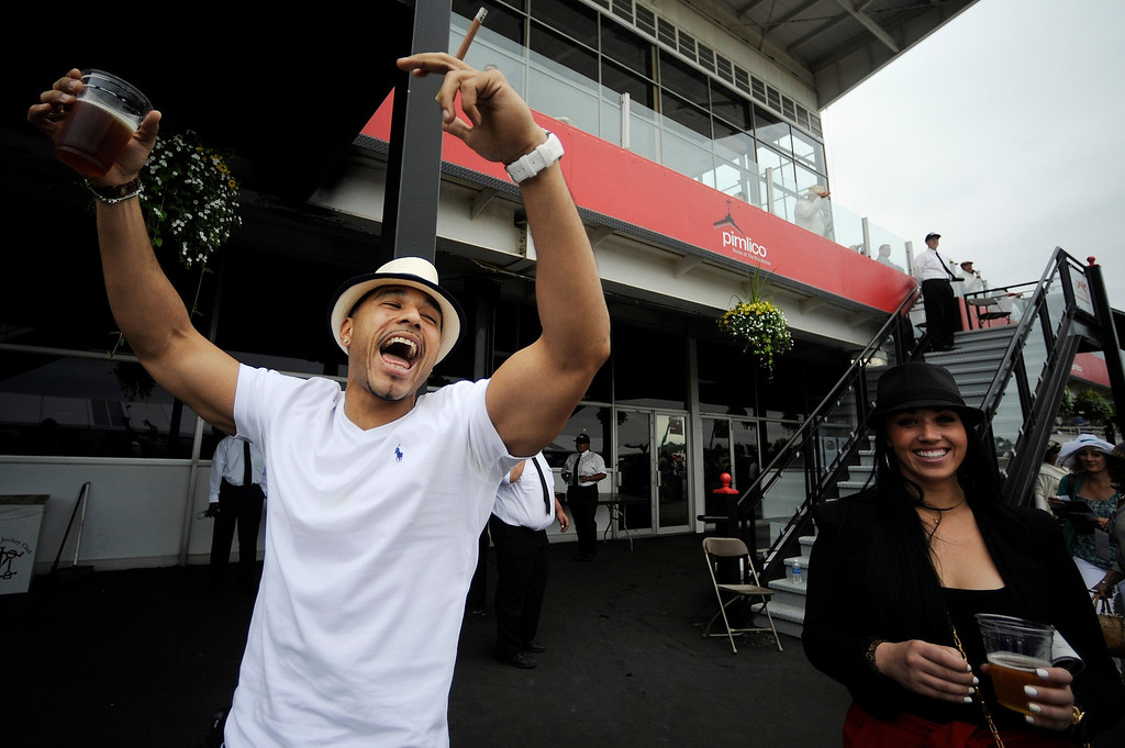 . Robert Mone, from the Brooklyn borough of New York, celebrates as Zee Bros wins the sixth horse race at Pimlico Race Course, Saturday, May 18, 2013, in Baltimore. The 138th Preakness Stakes horse race takes place Saturday. (AP Photo/Mike Stewart)