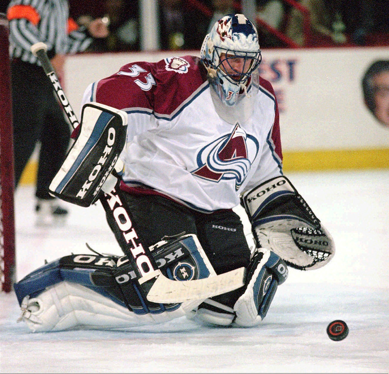 . Colorado Avalanche goalie Patrick Roy (33) makes a save against the Chicago Blackhawks during the second period at McNichols Sports Arena in Denver, Tuesday, Jan. 12, 1999. The game is Roy\'s first since Dec. 26, 1998, when he injured his left knee against the Dallas Stars. He has complained of back spasms since that game. (AP Photo/Jack Dempsey)