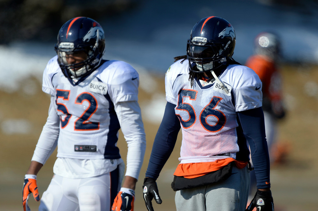 . Denver Broncos middle linebacker Wesley Woodyard (52) and Denver Broncos outside linebacker Nate Irving (56) look on during practice January 23, 2014 at Dove Valley. (Photo by John Leyba/The Denver Post)