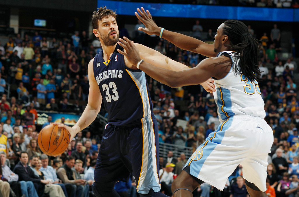 . Memphis Grizzlies center Marc Gasol, left, of Spain, looks to pass the ball under pressure from Denver Nuggets forward Kenneth Faried in the first quarter of an NBA basketball game in Denver, Friday, March 15, 2013. (AP Photo/David Zalubowski)