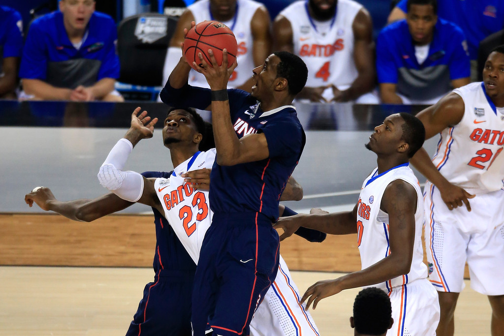 . ARLINGTON, TX - APRIL 05: DeAndre Daniels #2 of the Connecticut Huskies battles for a loose ball against Chris Walker #23 of the Florida Gators during the NCAA Men\'s Final Four Semifinal at AT&T Stadium on April 5, 2014 in Arlington, Texas.  (Photo by Jamie Squire/Getty Images)