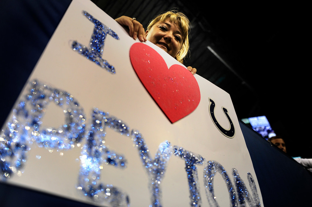 . Kelsey Gudmunson, 31, of Idaho, holds her sign before the Denver Broncos game against the Indianapolis Colts at Lucas Oil Stadium. (Photo By Joe Amon/The Denver Post)
