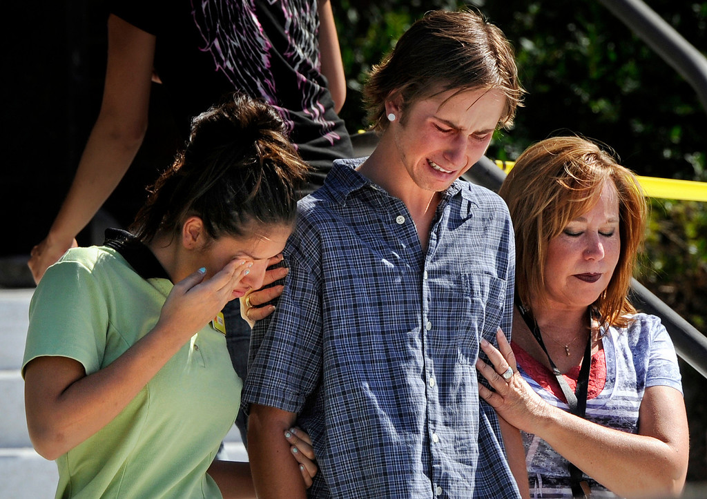 . Victims and witnesses leave Gateway High School after being picked up by friends and family members on July 20, 2012. Twelve people were killed and 58 were injured early Friday when shots rang out at an Aurora, Colorado movie theater during a premiere showing of the new Batman movie. Craig F. Walker, The Denver Post
