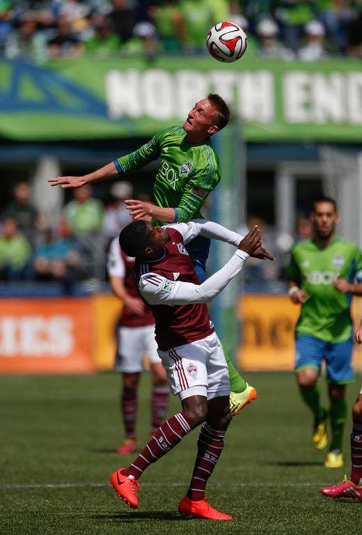 . Dylan Remick #15 of the Seattle Sounders FC battles Edson Buddle #9 of the Colorado Rapids at CenturyLink Field on April 26, 2014 in Seattle, Washington. (Photo by Otto Greule Jr/Getty Images)