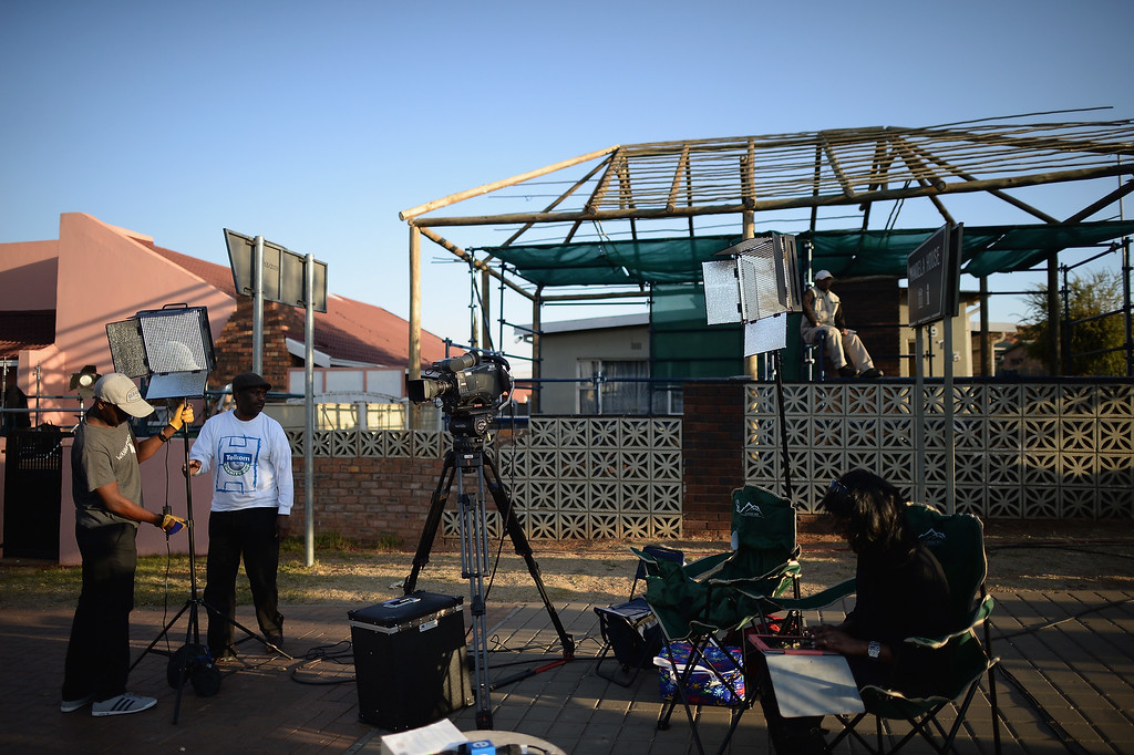 . JOHANNESBURG, SOUTH AFRICA - JUNE 27:  Media gather in Soweto Vilakazi Street as they await news of former South African President Nelson Mandela in Vilakazi Street on June 27, 2013 in Johannesburg, South Africa. South African President Jacob Zuma confirmed on June 23 that Mandela\'s condition has become critical since he was admitted to the hospital over two weeks ago for a recurring lung infection.  (Photo by Jeff J Mitchell/Getty Images)