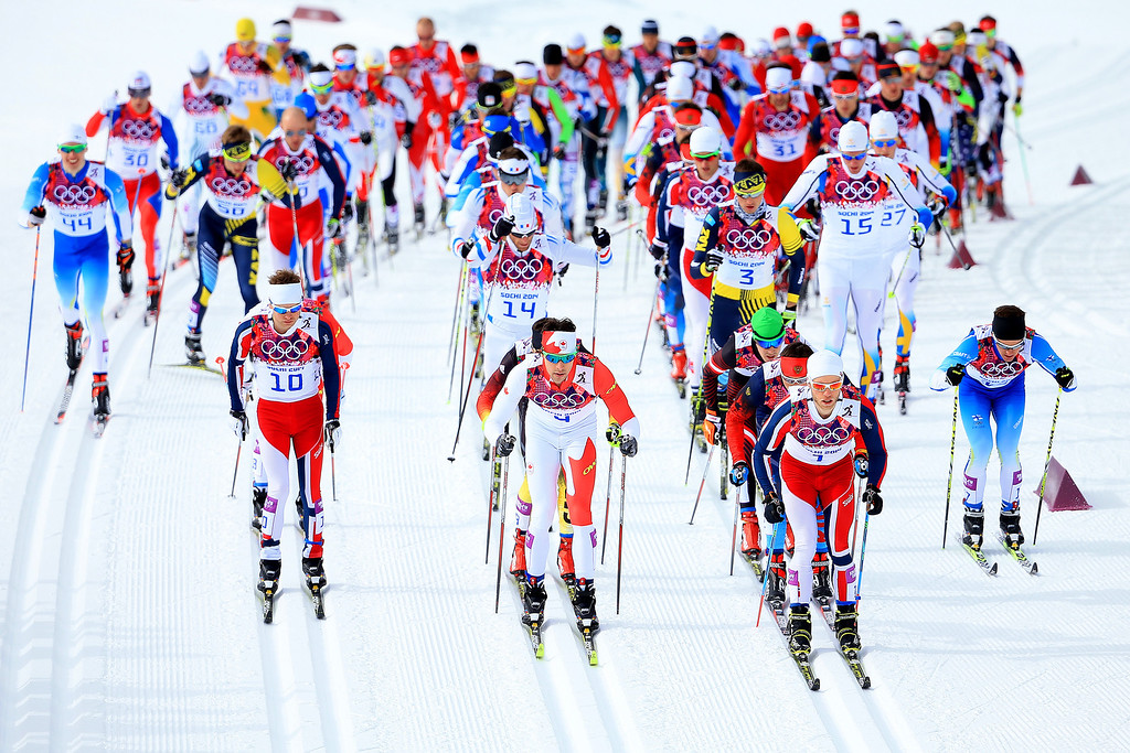 . Sjur Roethe of Norway, Alex Harvey of Canada and Martin Johnsrud Sundby of Norway lead the pack in the Men\'s Skiathlon 15 km Classic + 15 km Free during day two of the Sochi 2014 Winter Olympics at Laura Cross-country Ski & Biathlon Center on February 9, 2014 in Sochi, Russia.  (Photo by Richard Heathcote/Getty Images)