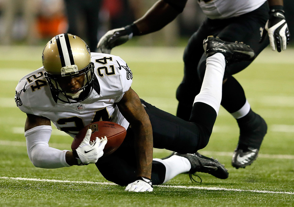 . Cornerback Corey White #24 of the New Orleans Saints recovers a fumble by wide receiver Darius Johnson #13 of the Atlanta Falcons during a game at the Georgia Dome on November 21, 2013 in Atlanta, Georgia.  (Photo by Kevin C. Cox/Getty Images)