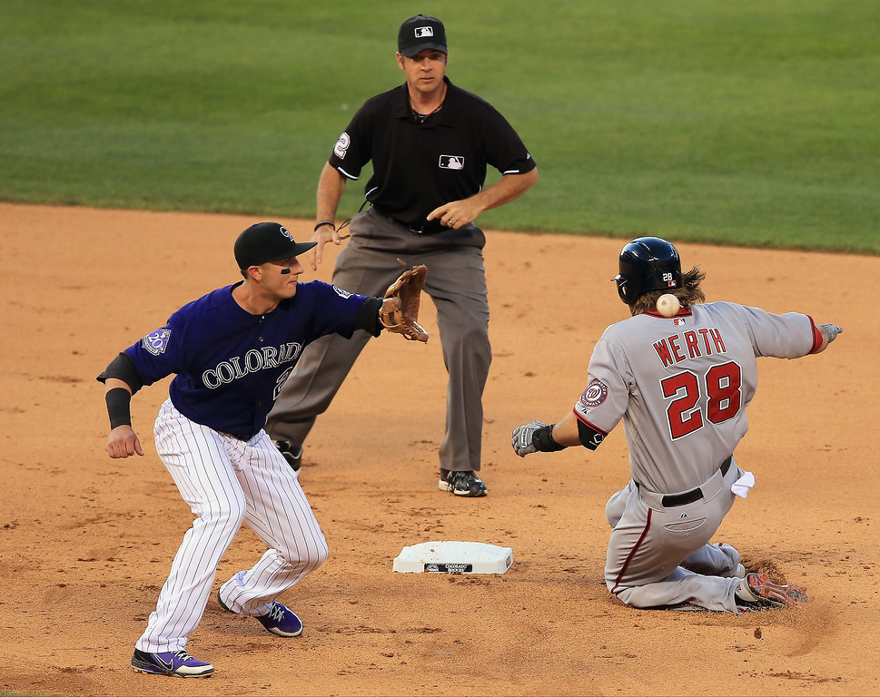 . Jayson Werth #28 of the Washington Nationals slides into second with a double as shortstop Troy Tulowitzki #2 of the Colorado Rockies takes the throw and umpire James Hoye oversees the action in the fifth inning at Coors Field on June 11, 2013 in Denver, Colorado.  (Photo by Doug Pensinger/Getty Images)