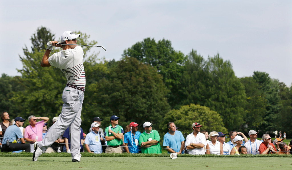 . Adam Scott, of Australia, hits his tee shot  on the ninth hole during the first round of the PGA Championship golf tournament at Oak Hill Country Club, Thursday, Aug. 8, 2013, in Pittsford, N.Y. (AP Photo/Patrick Semansky)