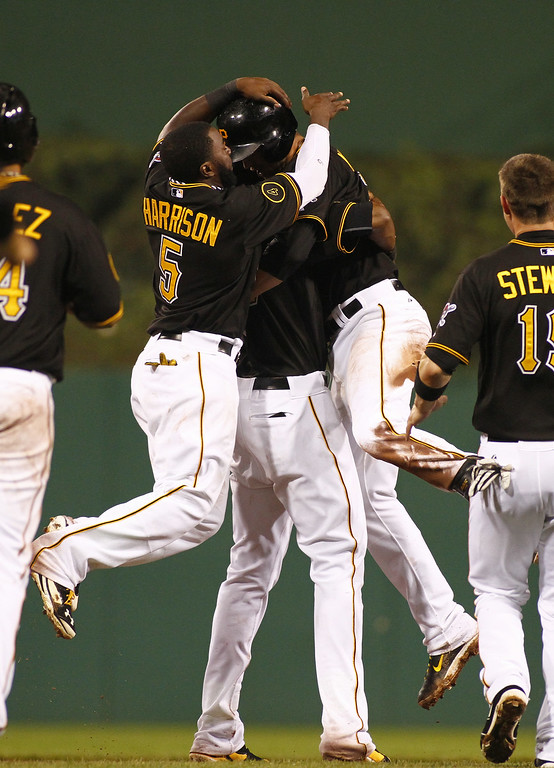 . PITTSBURGH, PA - JULY 19: Jordy Mercer #10 of the Pittsburgh Pirates celebrates with teammates after hitting a walk off double in the 11th inning against the Colorado Rockies at PNC Park July 19, 2014 in Pittsburgh, Pennsylvania. (Photo by Justin K. Aller/Getty Images)
