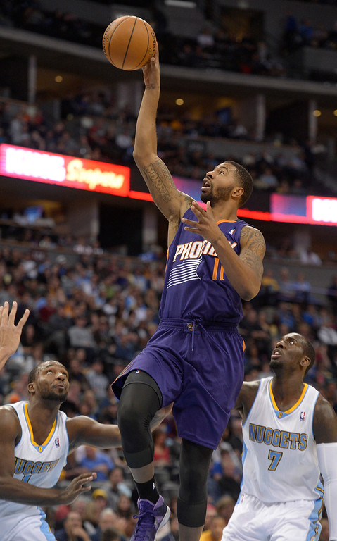 . Phoenix Suns power forward Markieff Morris (11) gets an easy basket as Denver Nuggets power forward J.J. Hickson (7) and Denver Nuggets shooting guard Jordan Hamilton (1) look on during the thrid quarter October 23, 2013 at Pepsi Center. (Photo By John Leyba/The Denver Post)