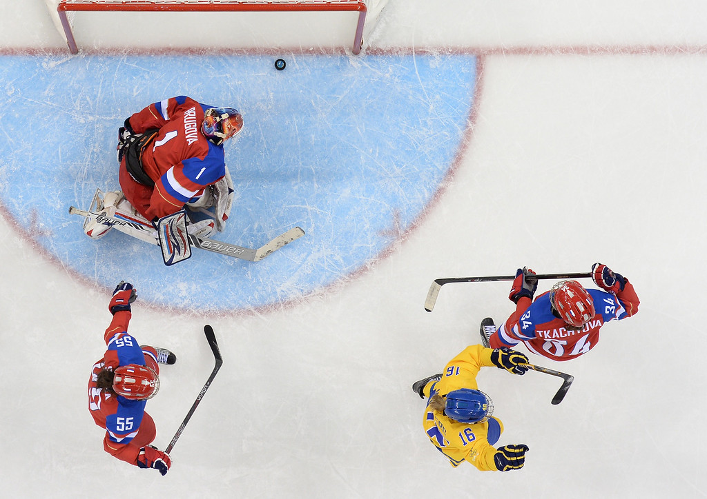. Sweden\'s Pernilla Winberg (2nd R) celebrates after scoring during the Women\'s Ice Hockey Group B match Sweden vs Russia at the Shayba Arena at the Sochi Winter Olympics on February 13, 2014 in Sochi.   ANDREJ ISAKOVIC/AFP/Getty Images
