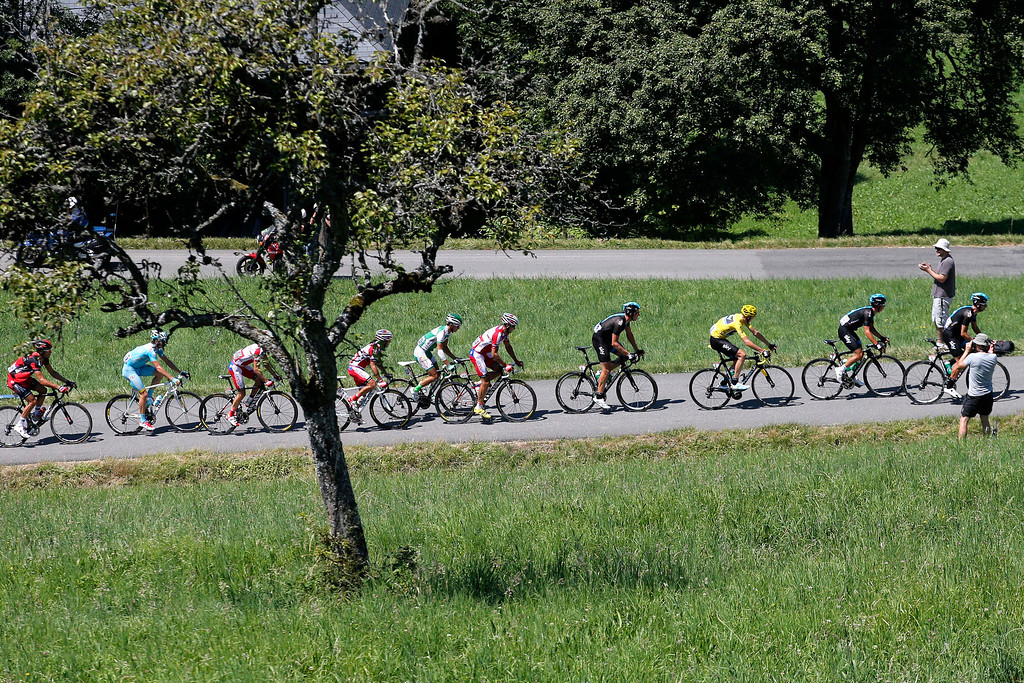 . The pack with Christopher Froome of Britain, wearing the overall leader\'s yellow jersey, rides during the 20th stage of the Tour de France cycling race over 125 kilometers (78.1 miles) with start in in Annecy and finish in Annecy-Semnoz, France, Saturday July 20 2013. (AP Photo/Christophe Ena)
