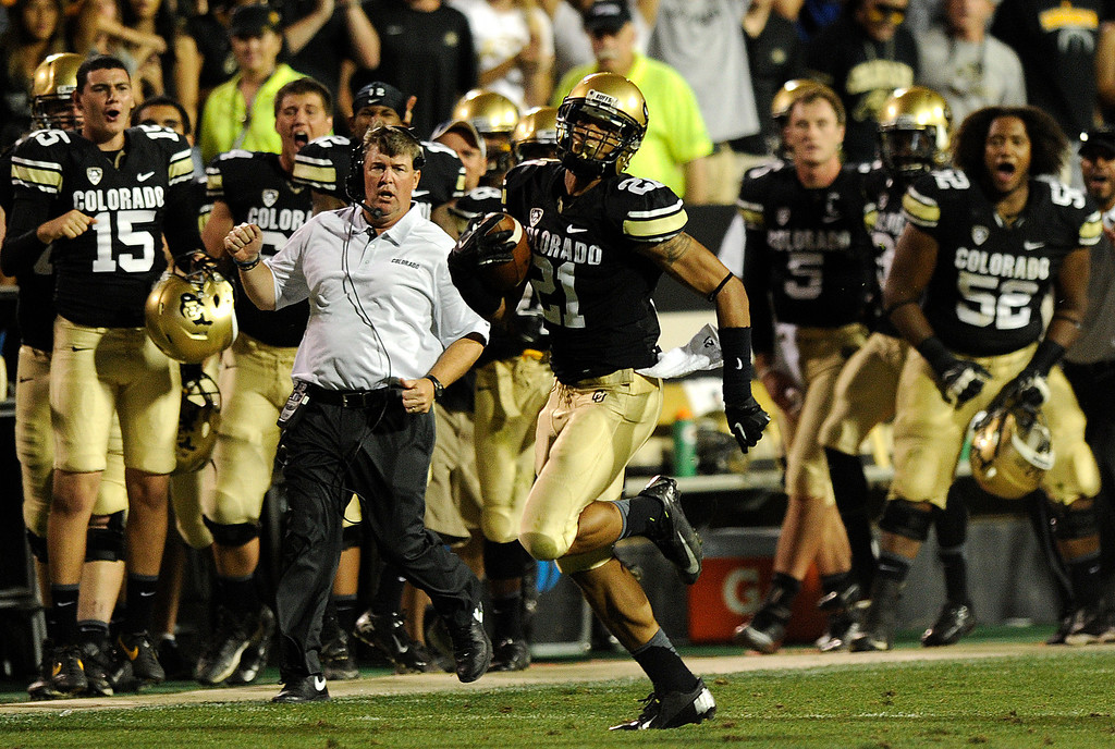 . BOULDER, CO. - SEPTEMBER 76: Buffs coach Mike MacIntyre reacted as defensive back Jared Bell ran back an interception for a touchdown in the fourth quarter. The University of Colorado football team hosted Central Arkansas at Folsom Field Saturday night, September 7, 2013. Photo By Karl Gehring/The Denver Post