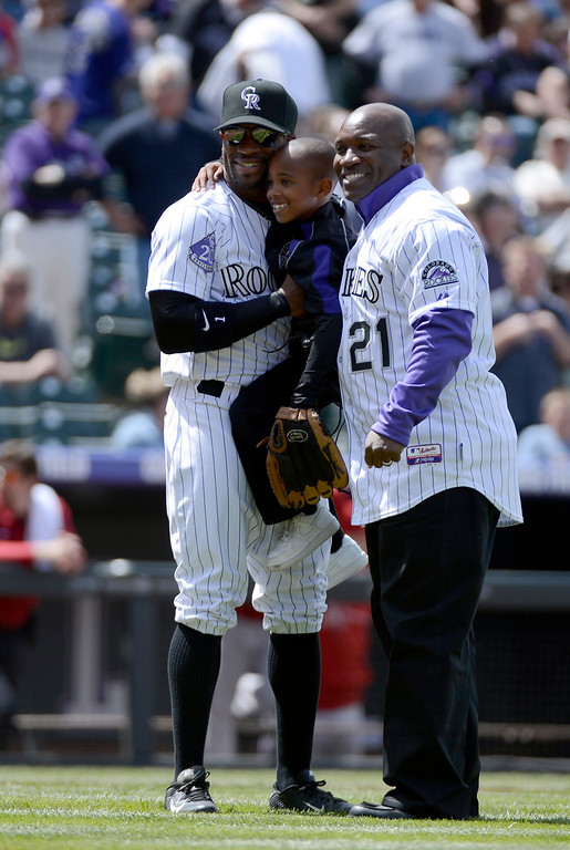 . DENVER, CO. - APRIL 21: Colorado Rockies retired player Eric Young (R) Dallas Young 6-years-old and Eric Young Jr. pose for a photo after throwing out the first pitch prior to their game against the Arizona DiamondBacks April 21, 2013 at Coors Field. (Photo By John Leyba/The Denver Post)