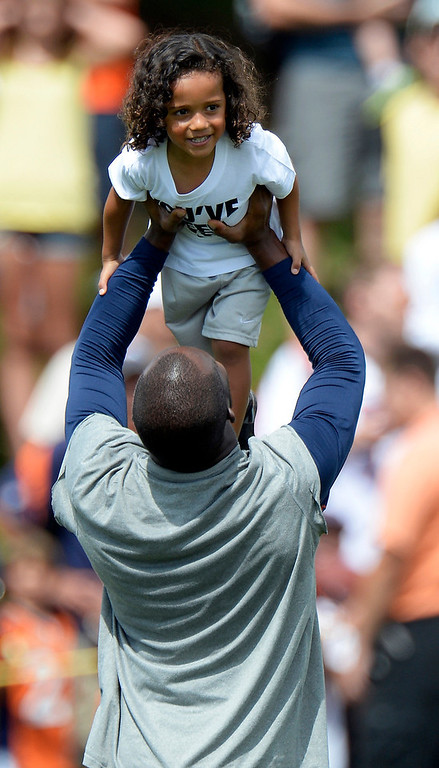 . ENGLEWOOD, CO. - AUGUST 1: Denver Broncos CB Champ Bailey holds his son Brayden Bailey up high after practice during training camp August 1, 2013 at Dove Valley. (Photo By John Leyba/The Denver Post)