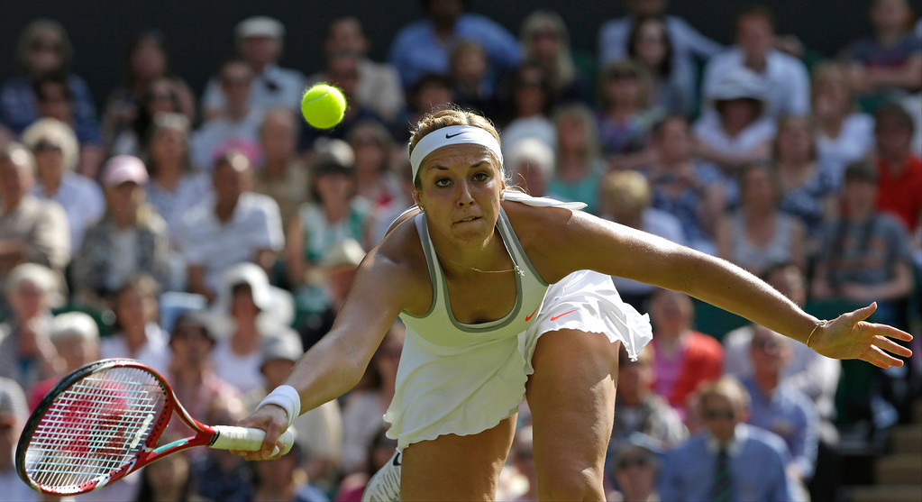 . Sabine Lisicki of Germany plays a return to Agnieszka Radwanska of Poland during their Women\'s singles semifinal match at the All England Lawn Tennis Championships in Wimbledon, London, Thursday, July 4, 2013. (AP Photo/Anja Niedringhaus)