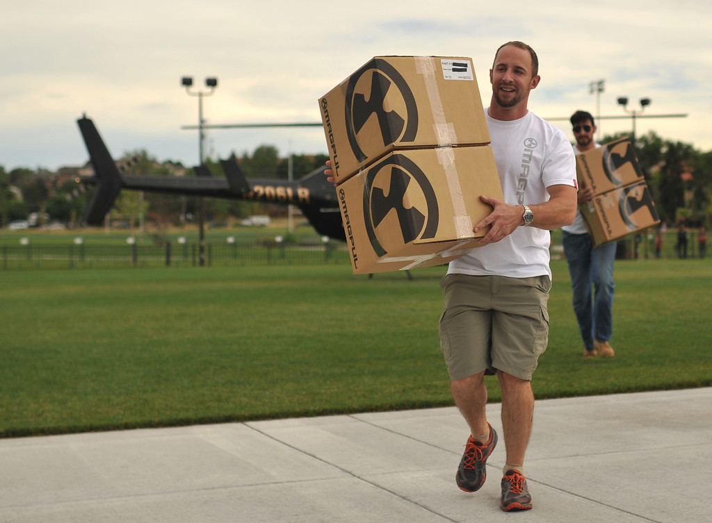 . GLENDALE, CO. - June 29: Volunteer Mike Toney moves the box of 30-round gun magazines from the helicopter to a tent at a farewell to arms freedom festival by Free Colorado in Infinity Park. Glendale, Colorado. June 29, 2013. Magpul Industries attended the party and handed out 1500 of their 30-round gun magazines for free.  (Photo By Hyoung Chang/The Denver Post)