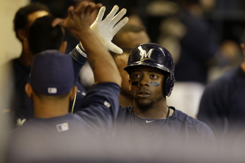 . MILWAUKEE, WI - APRIL 3:  Rickie Weeks #23 of the Milwaukee Brewers celebrates in the dugout after scoring on a double by Ryan Braun in the bottom of the seventh inning against the Colorado Rockies at Miller Park on April 3, 2013 in Milwaukee, Wisconsin. (Photo by Mike McGinnis/Getty Images)