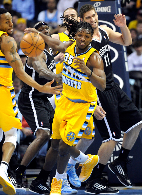 . DENVER, CO. - MARCH 29: Kenneth Faried (35) of the Denver Nuggets scrambled after a loose ball in the first half. The Denver Nuggets hosted the Brooklyn Nets Friday night, March 29, 2013 at the Pepsi Center in Denver.  (Photo By Karl Gehring/The Denver Post)