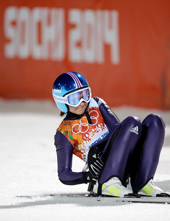 . Germany\'s Gianina Ernst checks the scoreboard after her first attempt during the women\'s normal hill ski jumping final at the 2014 Winter Olympics, Tuesday, Feb. 11, 2014, in Krasnaya Polyana, Russia. (AP Photo/Gregorio Borgia)