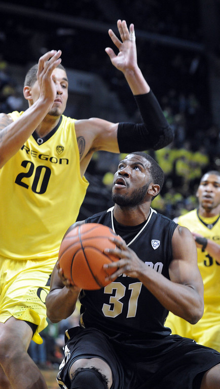 . Jeremy Adams #31 of the Colorado Buffaloes goes up for a shot on Waverly Austin #20 of the Oregon Ducks in the first half of the game  at Matthew Knight Arena on February 7, 2013 in Eugene, Oregon. (Photo by Steve Dykes/Getty Images)