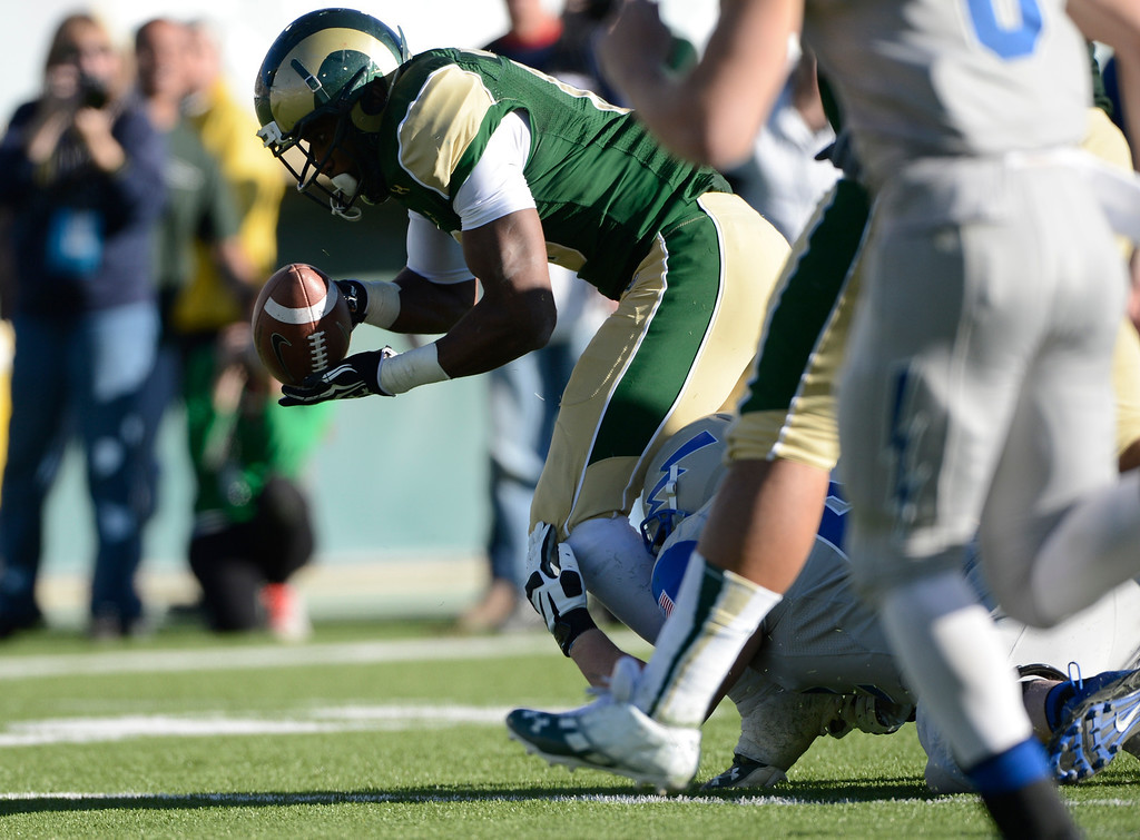 . Colorado State safety, Trent Matthews, scoops up a fumble against Air Force in the third quarter Saturday afternoon, setting up a touch down by Kapri Bibbs November 30, 2013. The Rams won 58-13. (Photo By Andy Cross/The Denver Post)