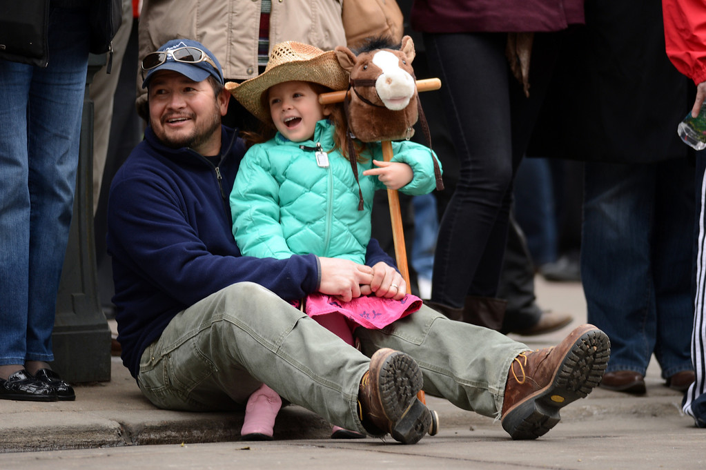 . Eric Vera of Golden, left, and his daughter Pearl, 4, are watching 107th National Western Stock Show Kick-Off Parade at Downtown Denver on Thursday. Denver, CO, January 10, 2013.  Hyoung Chang, The Denver Post