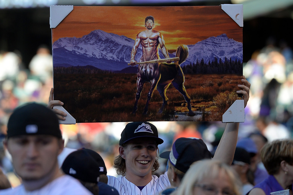 . A fan holds a painting paying homage to Todd Helton before the start of action in Denver. The Colorado Rockies hosted the Boston Red Sox and said farewell to longtime first baseman Todd Helton, who recently announced his retirement following this season. (Photo by John Leyba/The Denver Post)