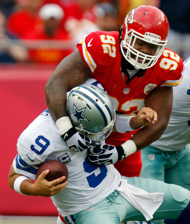 . Dallas Cowboys quarterback Tony Romo (9) is sacked by Kansas City Chiefs nose tackle Dontari Poe (92) during the first half of an NFL football game at Arrowhead Stadium in Kansas City, Mo., Sunday, Sept. 15, 2013. (AP Photo/Ed Zurga)