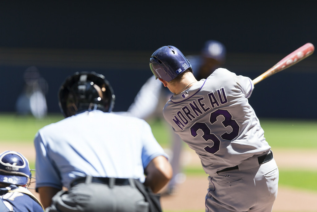 . Justin Morneau #33 of the Colorado Rockies hits an RBI pop up to center against the Milwaukee Brewers at Miller Park on June 29, 2014 in Milwaukee, Wisconsin.  (Photo by Tom Lynn/Getty Images)