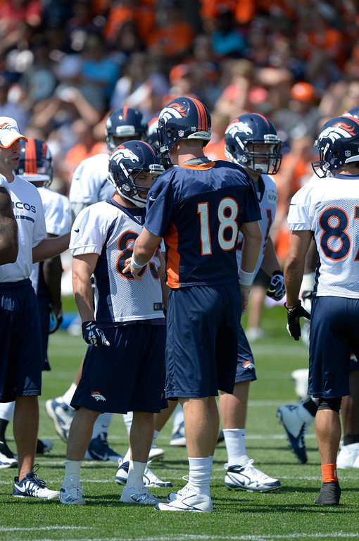 . Denver Broncos QB Peyton Manning (18) talks with WR Wes Welker during training camp July 26, 2013 at Dove Valley. (Photo By John Leyba/The Denver Post)