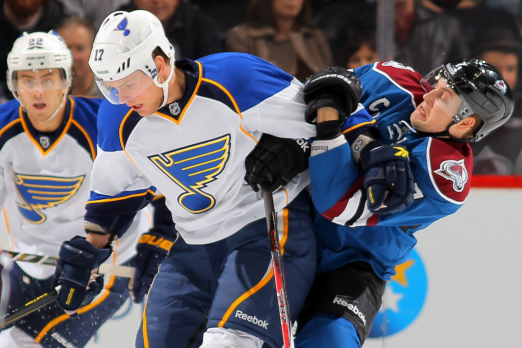 . Vladimir Sobotka #17 of the St. Louis Blues battles for position with John Mitchell #7 of the Colorado Avalanche at the Pepsi Center on February 20, 2013 in Denver, Colorado.  (Photo by Doug Pensinger/Getty Images)