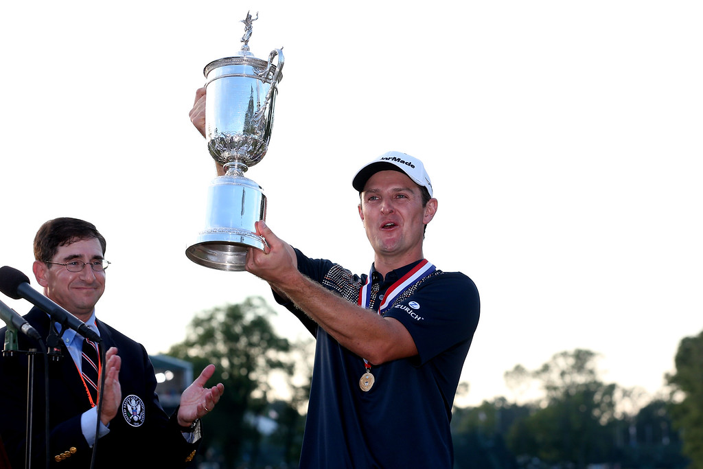 . ARDMORE, PA - JUNE 16:  Justin Rose of England celebrates with the U.S. Open trophy after winning the 113th U.S. Open at Merion Golf Club on June 16, 2013 in Ardmore, Pennsylvania.  (Photo by Andrew Redington/Getty Images)