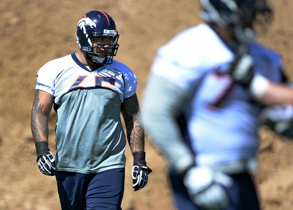 . Denver Broncos Louis Vasquez (65) watches drills during OTAs  June 2, 2014 at Dove Valley. (Photo by John Leyba/The Denver Post)