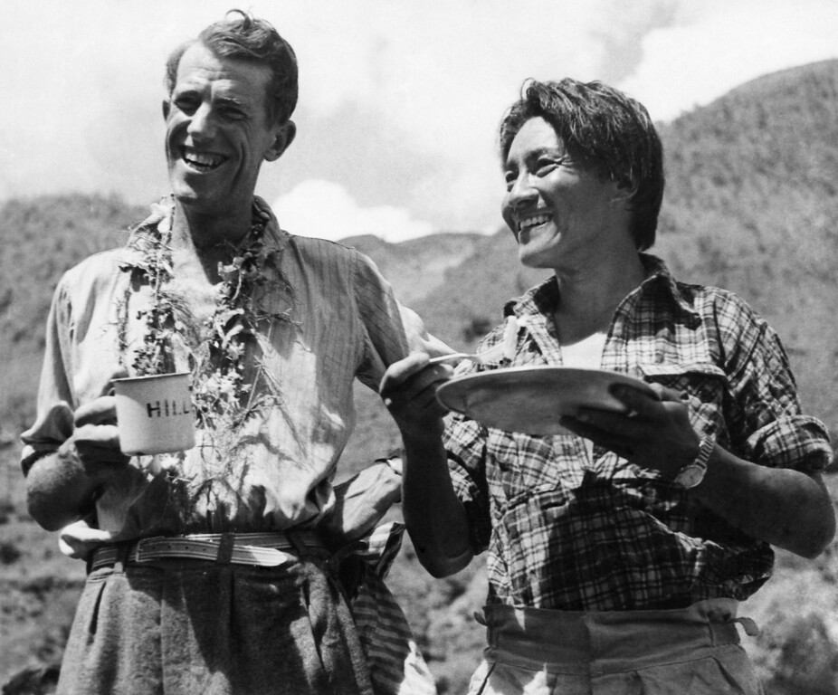 . Edmund Hillary and Sherpa Tenzing Norgay smile as they have breakfast in Kathmandu, Nepal after a 170-mile trek from their conquest of Mount Everest on June 20, 1953. (AP Photo)