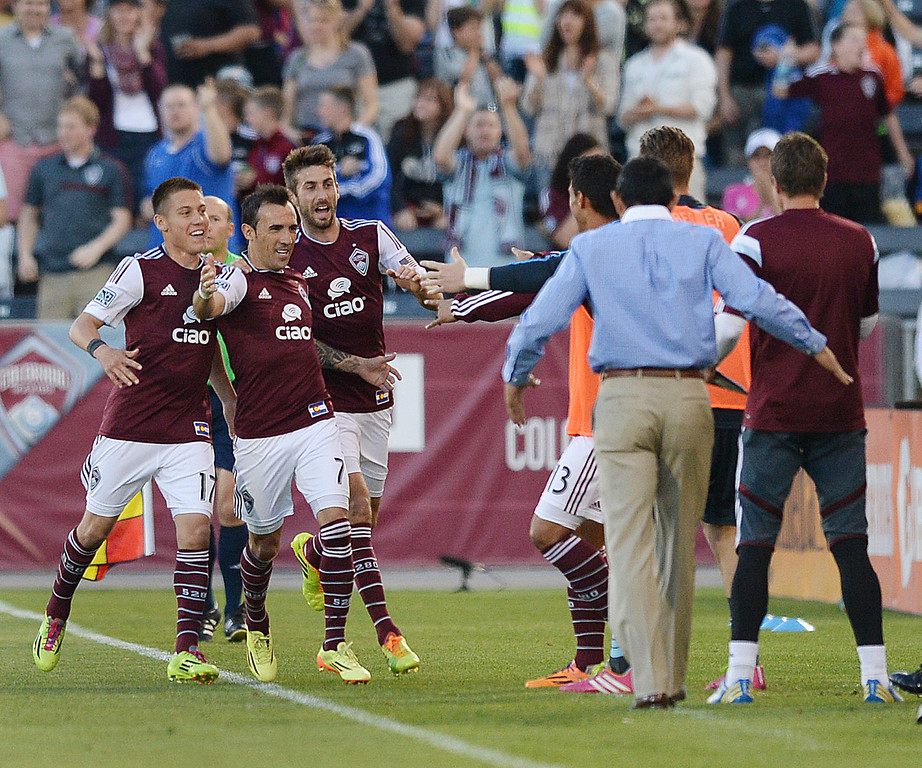 . COMMERCE CITY, CO - MAY 3:  Colorado forward Vicente Sanchez (7) came to the bench to celebrate his first half goal Saturday night. The Colorado Rapids hosted the Los Angeles Galaxy Saturday night, May 3, 2014 at Dick\'s Sporting Good Park. (Photo by Karl Gehring/The Denver Post)