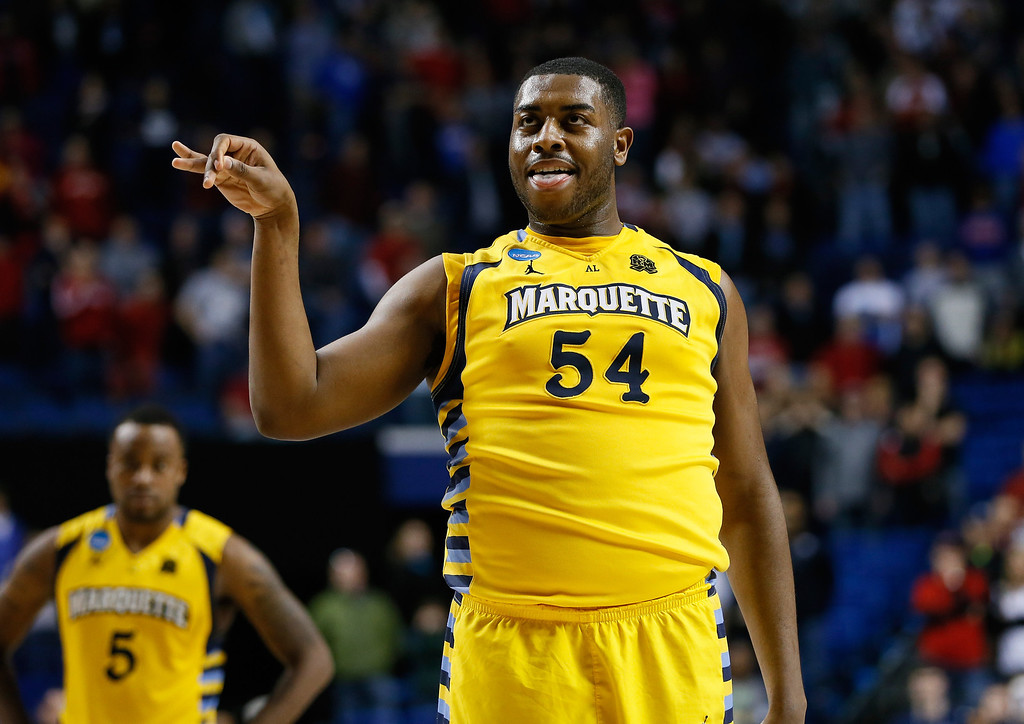 . LEXINGTON, KY - MARCH 23: Davante Gardner #54 of the Marquette Golden Eagles reacts after making a late free throw  in the game against the Butler Bulldogs during the third round of the 2013 NCAA Men\'s Basketball Tournament at Rupp Arena on March 23, 2013 in Lexington, Kentucky.  (Photo by Kevin C. Cox/Getty Images)