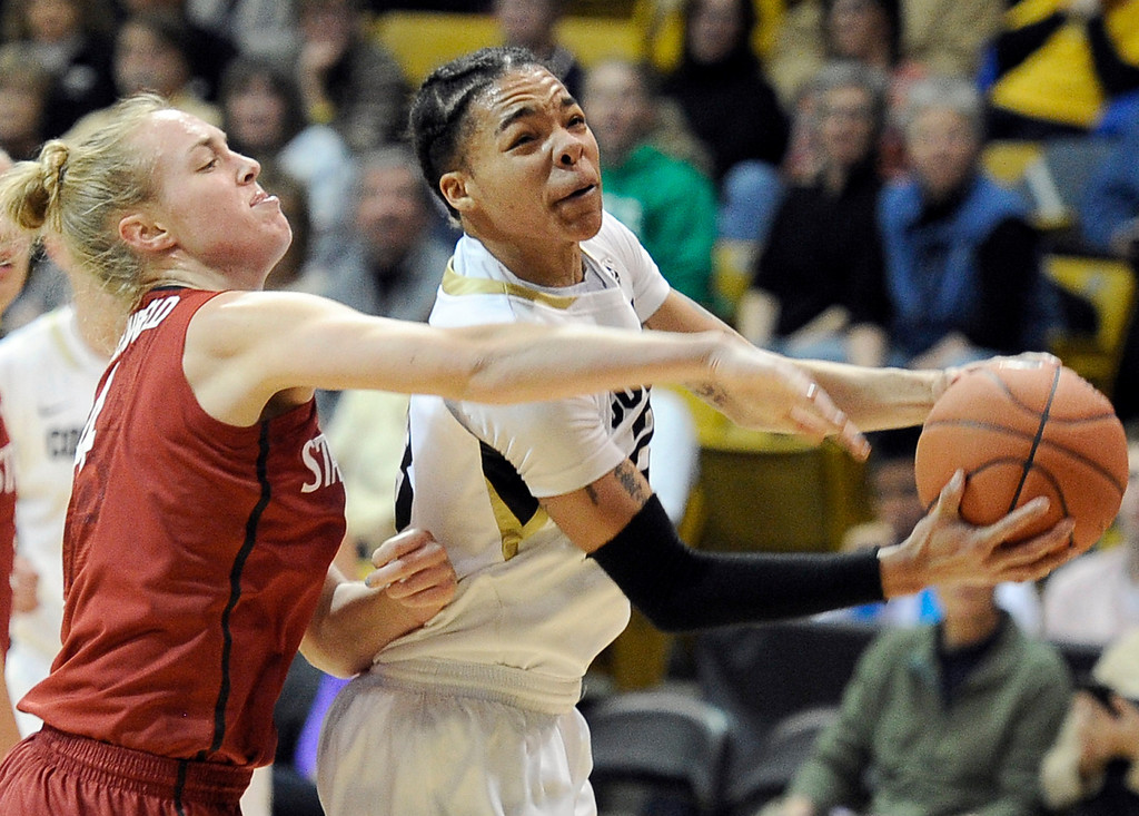 . University of Colorado\'s Chucky Jeffery goes for a layup in front of Taylor Greenfield during a game against Stanford on Friday, Jan. 4, at the Coors Event Center on the CU campus in Boulder.    Jeremy Papasso/Camera