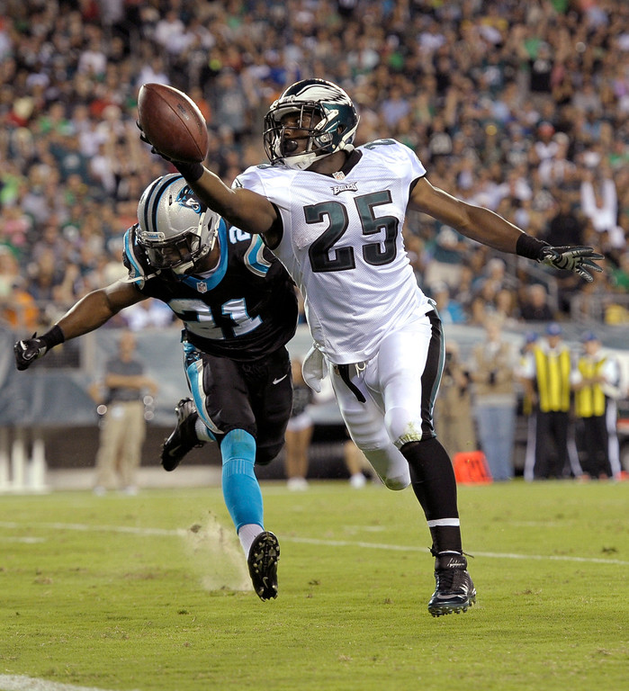 . Philadelphia Eagles running back LeSean McCoy, right, scores a touchdown past Carolina Panthers safety Mike Mitchell during the first half of a preseason NFL football game, Thursday, Aug. 15, 2013, in Philadelphia. (AP Photo/Michael Perez)