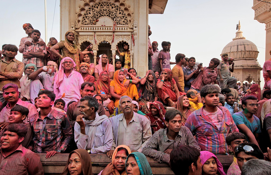 . Indian Hindu devotees wait outside the Ladali or Radha temple during the Lathmar Holy festival, the legendary hometown of Radha, consort of Hindu God Krishna, in Barsana 115 kilometers ( 71 miles)  from New Delhi, India , Thursday, March 21, 2013. During Lathmar Holi the women of Barsana beat the men from Nandgaon, the hometown of Krishna, with wooden sticks in response to their teasing as they depart the town. (AP Photo/Manish Swarup)