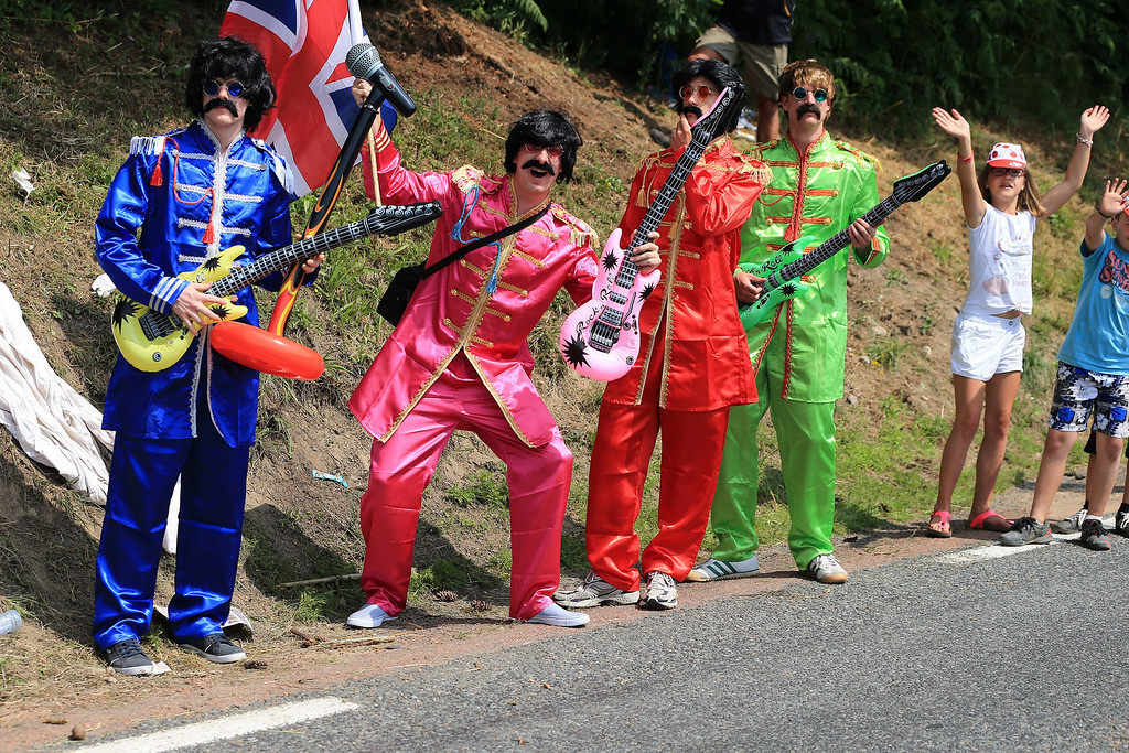 . LYON, FRANCE - JULY 13: Fans dressed as The Beatles enjoy the atmosphere during stage fourteen of the 2013 Tour de France, a 191KM road stage from Saint-Pourcain-sur-Sioule to Lyon, on July 13, 2013 in Lyon, France.  (Photo by Doug Pensinger/Getty Images)
