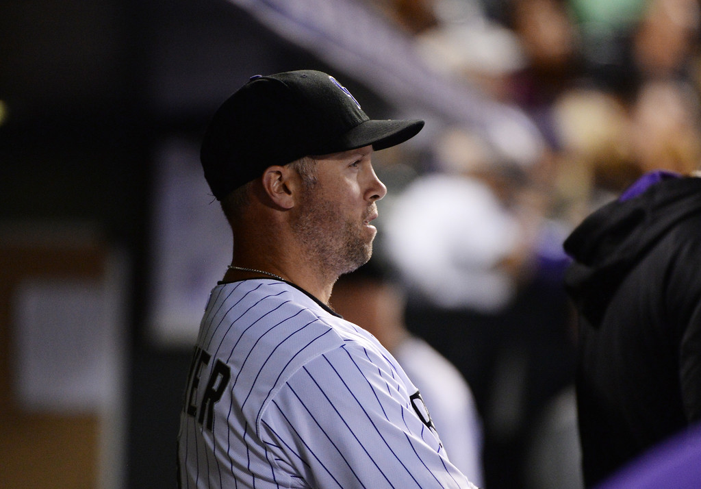 . DENVER JUNE 06: Michael Cuddyer of Colorado Rockies (3) is watching the game against Los Angeles Dodgers from the dugout at Coors Field in Denver, Colorado June 6, 2014. (Photo by Hyoung Chang/The Denver Post)