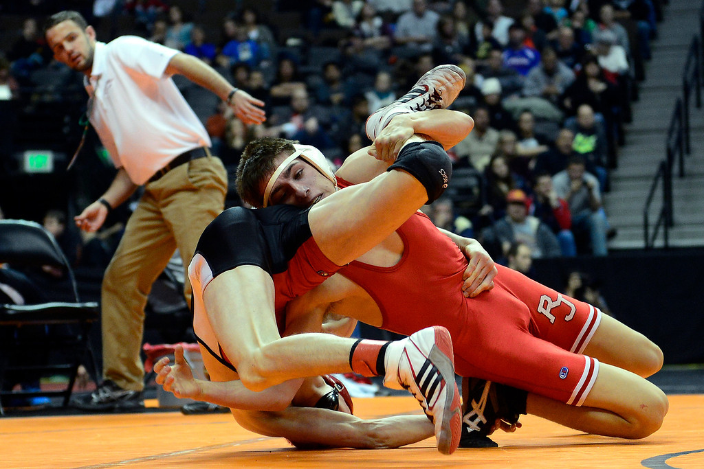 . DENVER, CO - FEBRUARY 21:  Regis Jesuit\'s Josh Redman scores the winning takedown in a 9-7 overtime win against Brighton\'s Eric Yamaguchi during the Colorado State High School Wrestling Championships. The state finals will run through Saturday evening at the Pepsi Center. (Photo by AAron Ontiveroz/The Denver Post)