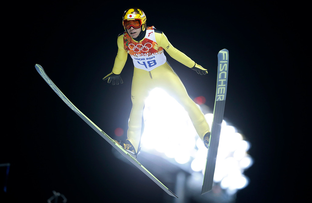 . Japan\'s Noriaki Kasai makes his trial jump during the men\'s normal hill ski jumping final at the 2014 Winter Olympics, Sunday, Feb. 9, 2014, in Krasnaya Polyana, Russia. (AP Photo/Matthias Schrader)