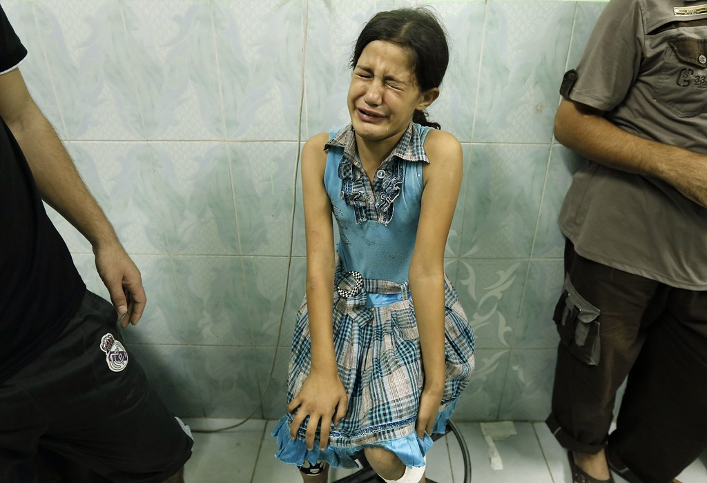 ". A Palestinian girl, wounded in an Israeli strike on a compound housing a UN school in Beit Lahia in the northern Gaza Strip, is pictured at Kamal Edwan hospital in Beit Lahia early on July 30, 2014.  Israeli bombardments early on July 30 killed ""dozens\"" of Palestinians in Gaza, including at least 16 at a UN school, medics said, on day 23 of the Israel-Hamas conflict.     AFP PHOTO / MOHAMMED ABED/AFP/Getty Images"